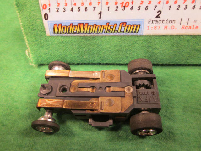 Bottom view of Aurora AFX 1970 Dated Slot Car Chassis (pre Magna-Traction)