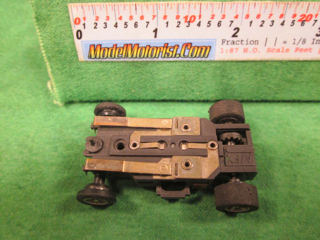 Bottom view of Aurora AFX Super-Traction Slot Car Chassis (pre Magna-Traction)