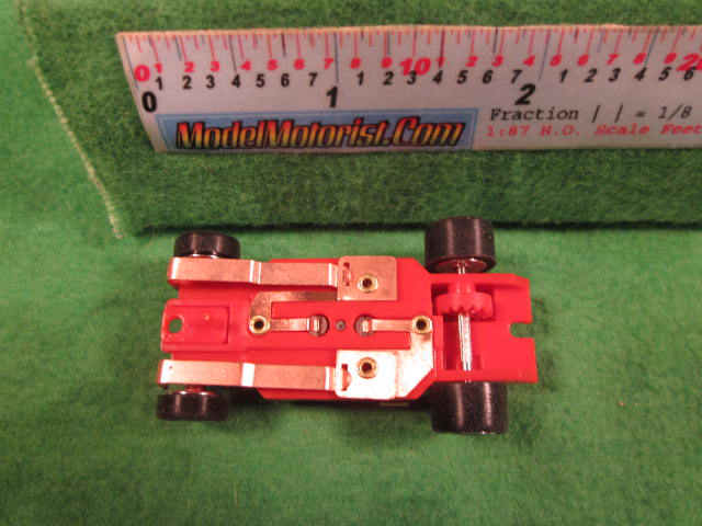 Bottom view of Dash IROC Corrected Red HO Slot Car Chassis