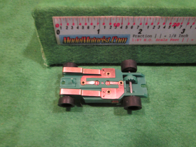 Bottom view of Dash IROC Green HO Slot Car Chassis