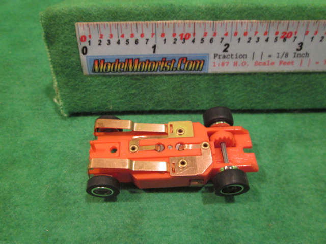 Bottom view of Dash IROC Error Red HO Slot Car Chassis