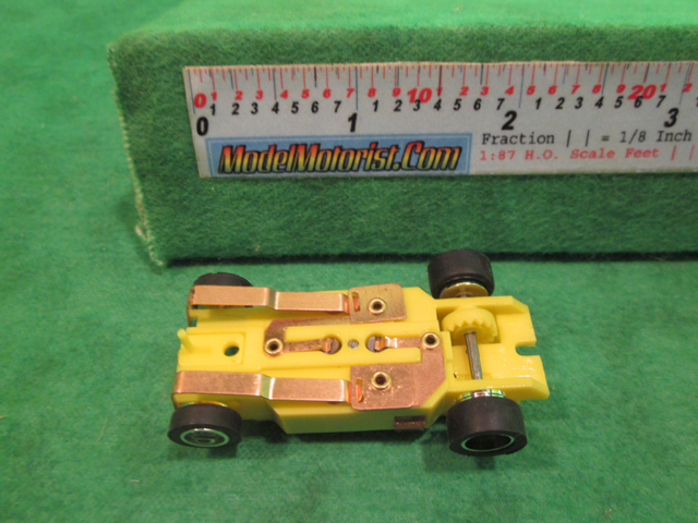 Bottom view of Dash IROC Yellow HO Slot Car Chassis