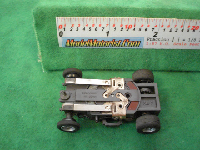 Bottom view of Aurora AFX Magna-Traction Flamethrower Slot Car Chassis