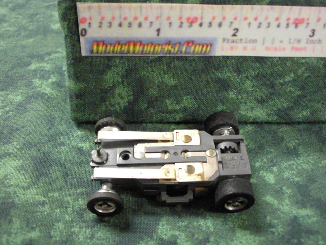 Bottom view of Aurora AFX 1971 Dated Slot Car Chassis (pre Magna-Traction)