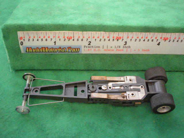 Bottom view of Aurora AFX Dragster Slot Car Chassis (pre Magna-Traction)