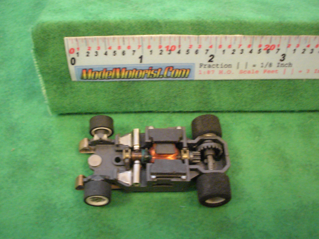 Top view of Aurora AFX G-Plus Narrow Fixed Axle Slot Car Chassis