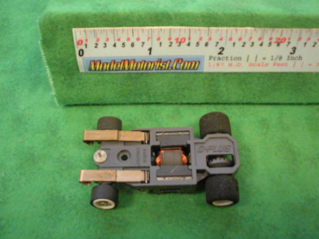 Bottom view of Aurora AFX G-Plus Narrow Fixed Axle Slot Car Chassis