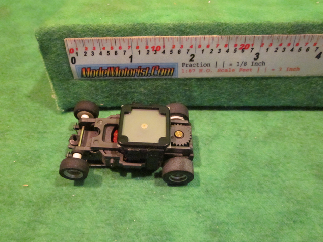 Top view of Aurora AFX Magna-Sonic 4 Arm Clip Slot Car Chassis