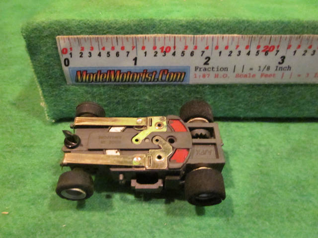 Bottom view of Aurora AFX Magna-Sonic 2 Arm Clip Slot Car Chassis