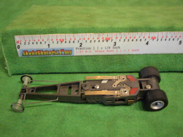 Bottom view of Aurora AFX Magna-Traction Specialty Dragster Slot Car Chassis