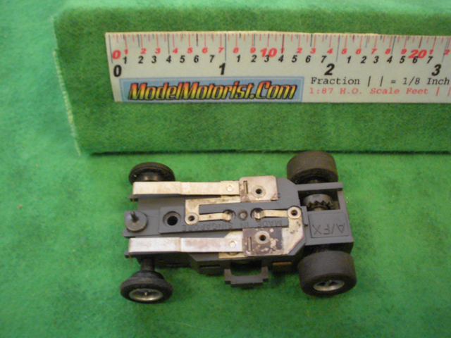 Bottom view of Aurora AFX Slot Car Chassis (pre Magna-Traction)