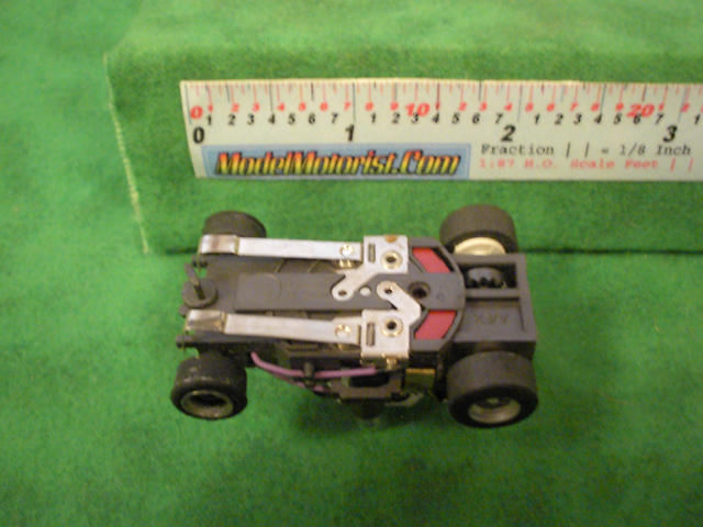 Bottom view of Aurora AFX Stop Police Slot Car Chassis