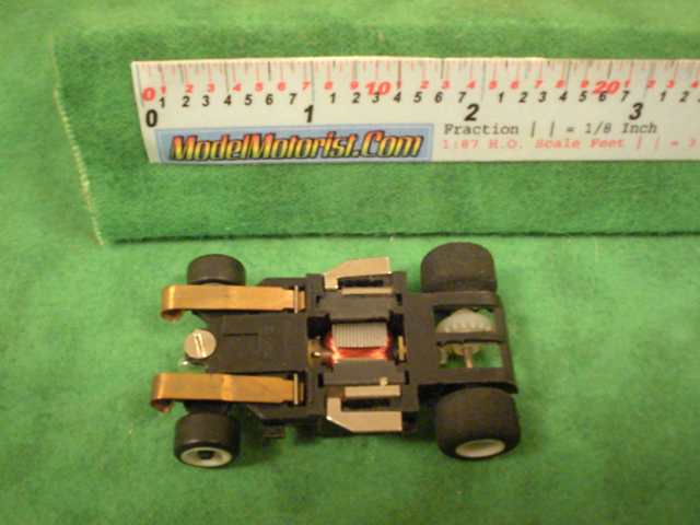 Bottom view of Amrac Lighted HO Scale Slot Car Chassis