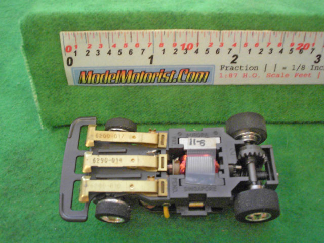 Bottom view of Aurora Speed-Steer Jam HO Slotless Car Chassis