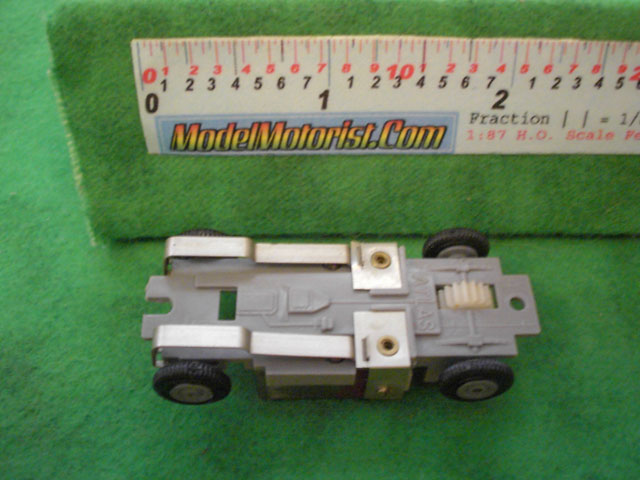 Bottom view of Atlas HO Scale Slot Car Chassis