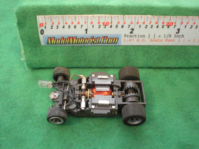 Top view of Aurora AFX Cat's Eyes Slot Car Chassis