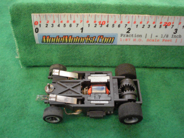 Bottom view of Aurora AFX Cat's Eyes Slot Car Chassis
