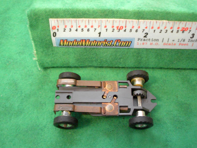 Bottom view of Aurora Thunderjet Formula 1 / Slim Line Slot Car Chassis