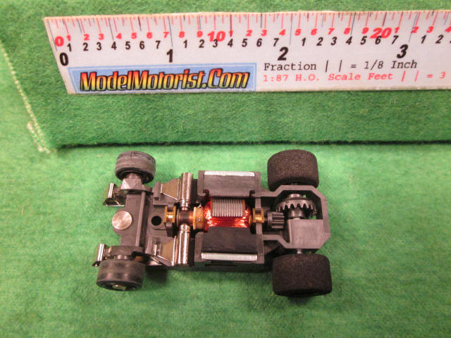 Top view of Aurora AFX G-Plus Narrow Snap-In Axle Slot Car Chassis