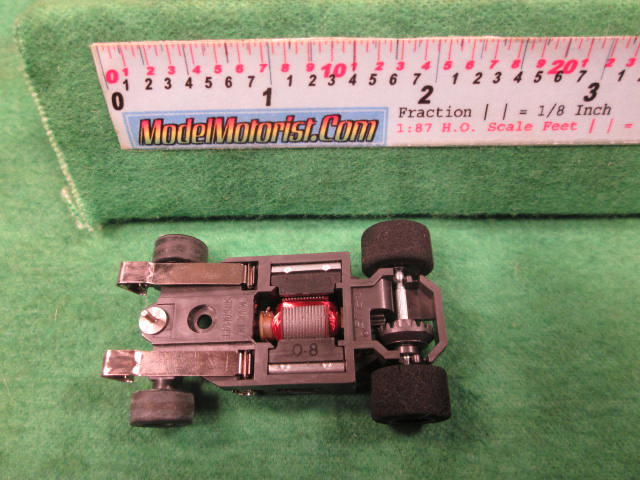 Bottom view of Aurora AFX G-Plus Narrow Snap-In Axle Slot Car Chassis