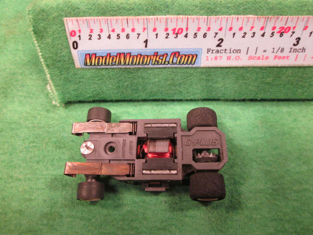 Bottom view of Aurora AFX G-Plus Wide Fixed Axle Slot Car Chassis