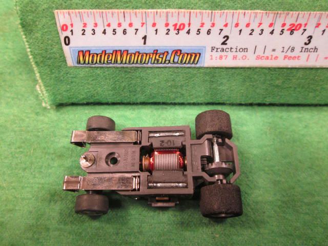 Bottom view of Aurora AFX G-Plus Wide Snap-In Axle Slot Car Chassis