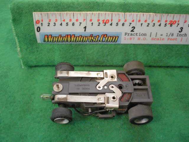 Bottom view of Aurora AFX Magna-Traction Lighted Slot Car Chassis
