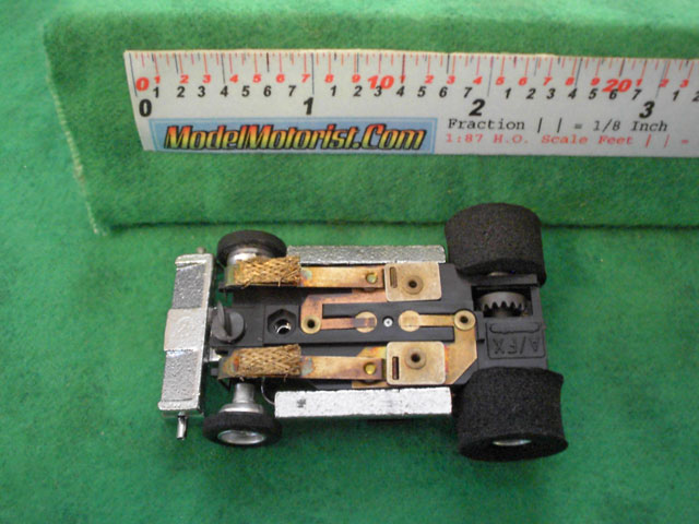 Bottom view of Aurora Super II Slot Car (boxed kit) Chassis (pre Magna-Traction)