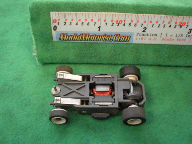 Bottom view of Aurora AFX SP-1000 Slot Car Chassis
