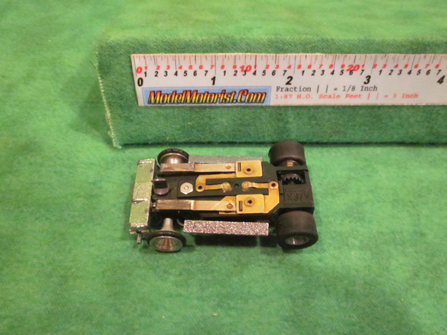 Bottom view of Aurora Super II Slot Car Chassis (pre Magna-Traction)