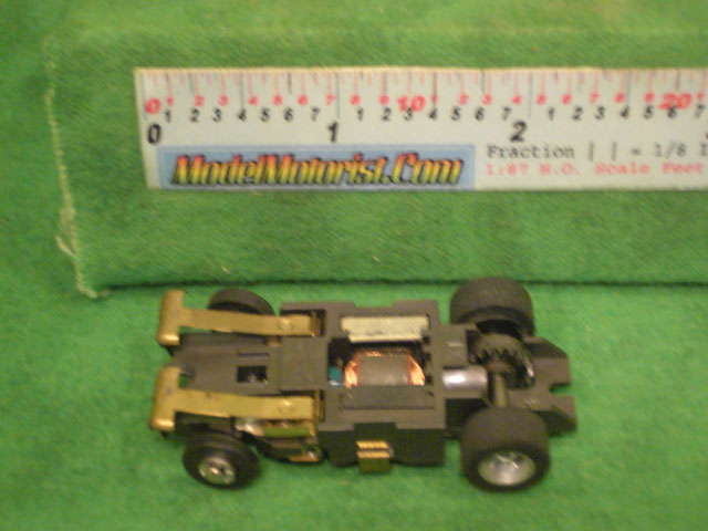 Bottom view of Aurora XLerators II Diode 4 HO Slotless Car Chassis