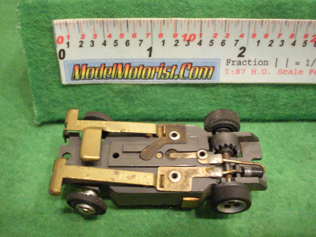 Bottom view of Aurora XLerators Diode 2 HO Slotless Car Chassis