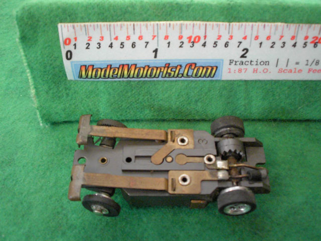 Bottom view of Aurora XLerators Diode 3 HO Slotless Car Chassis