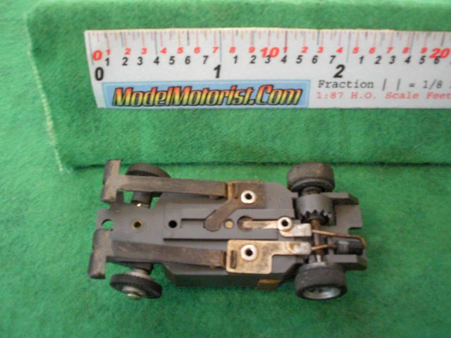Bottom view of Aurora XLerators Diode 4 HO Slotless Car Chassis