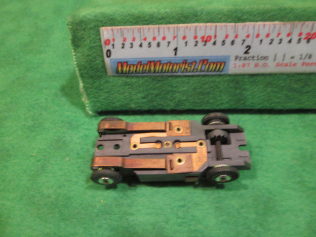 Bottom view of Bauer 60's HO Slot Car Chassis