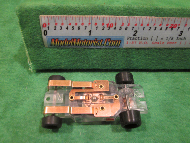 Bottom view of Dash Transparent HO Slot Car Chassis
