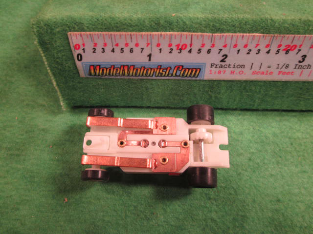 Bottom view of Dash Glow-In-The-Dark HO Slot Car Chassis