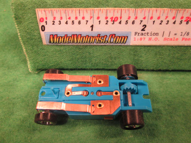 Bottom view of Dash Light Blue HO Slot Car Chassis