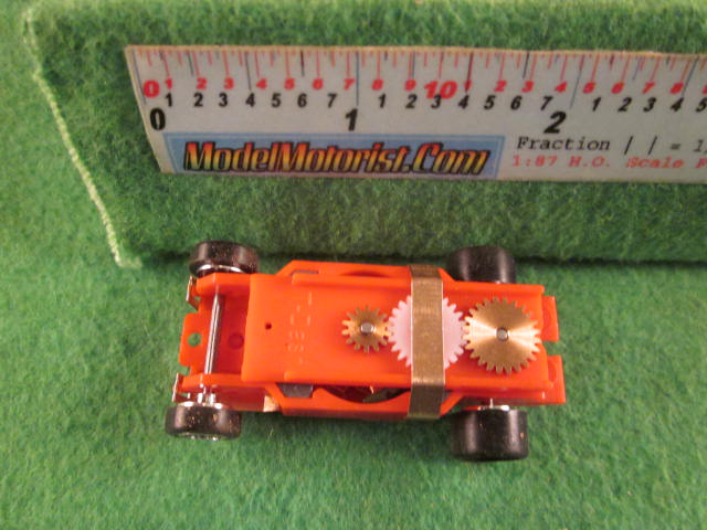 Top view of Dash Mondo Grip IROC Red HO Slot Car Chassis