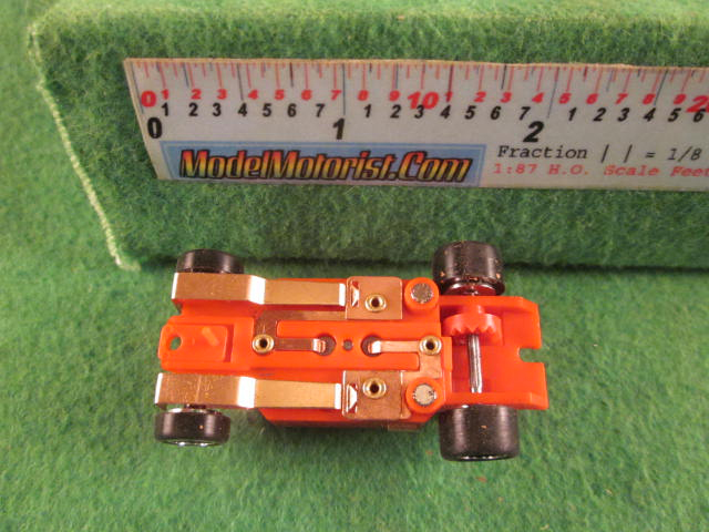 Bottom view of Dash Mondo Grip IROC Red HO Slot Car Chassis