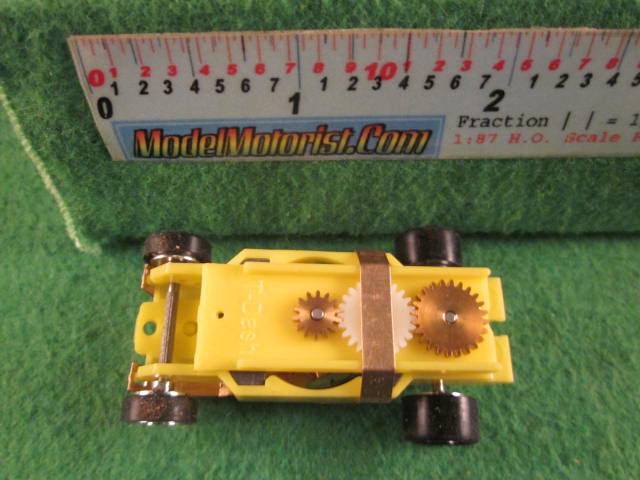 Top view of Dash Mondo Grip IROC Yellow HO Slot Car Chassis