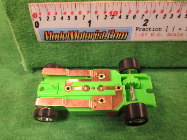 Bottom view of Dash Neon Green HO Slot Car Chassis