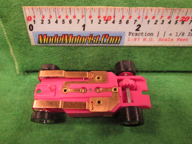 Bottom view of Dash Pink HO Slot Car Chassis