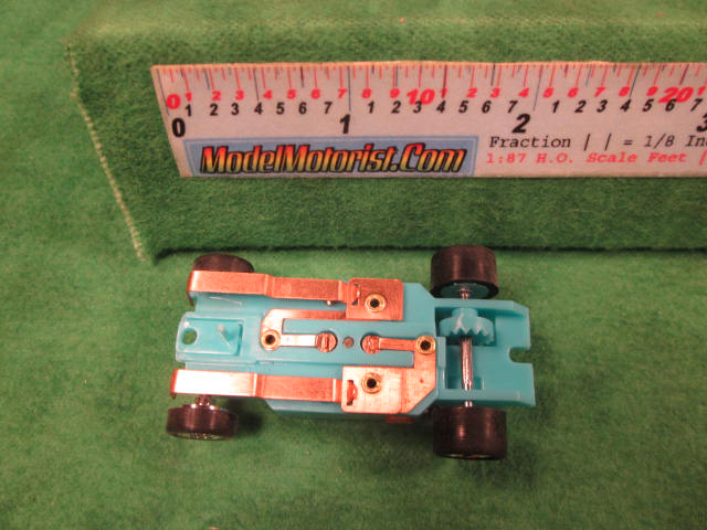 Bottom view of Dash Turquoise HO Slot Car Chassis
