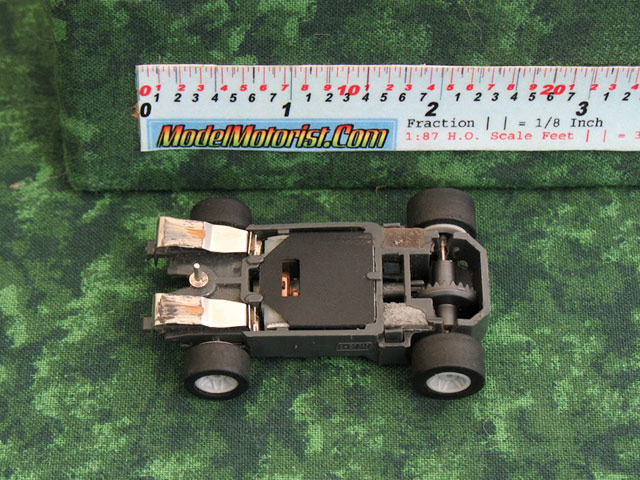 Bottom view of Empire MR1 Racing No Mount HO Slot Car Chassis