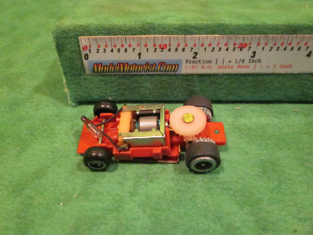 Top view of Ideal Passing MK2 Red B HO Slotless Car Chassis