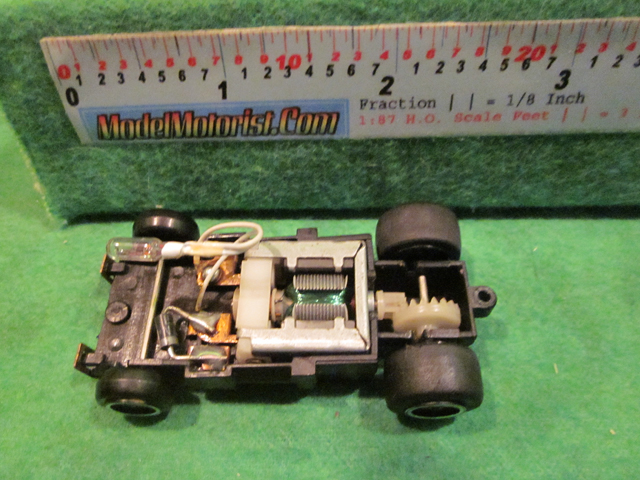 Top view of Ideal Lighted Bi-Directional HO Slot Car Chassis