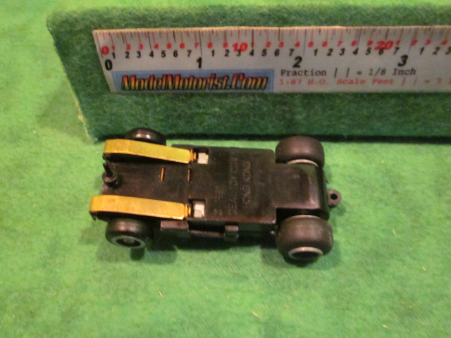 Bottom view of Ideal Lighted Bi-Directional HO Slot Car Chassis