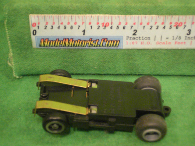 Bottom view of Ideal Bi-Directional HO Slot Car Chassis
