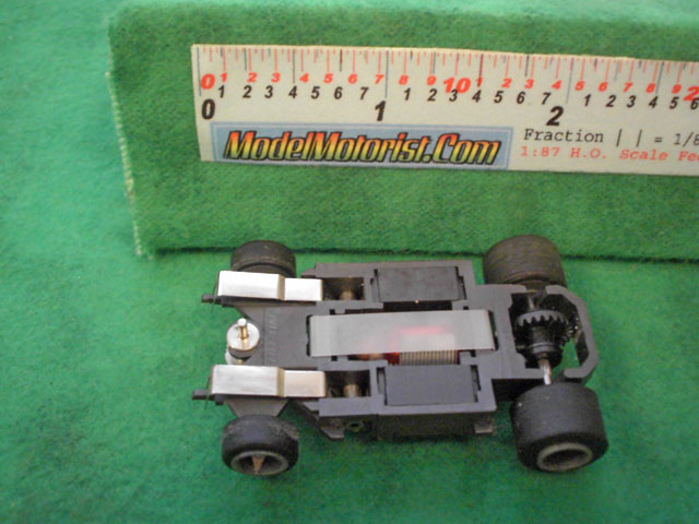 Bottom view of Life-Like Lighted M-Car HO Slot Car Chassis